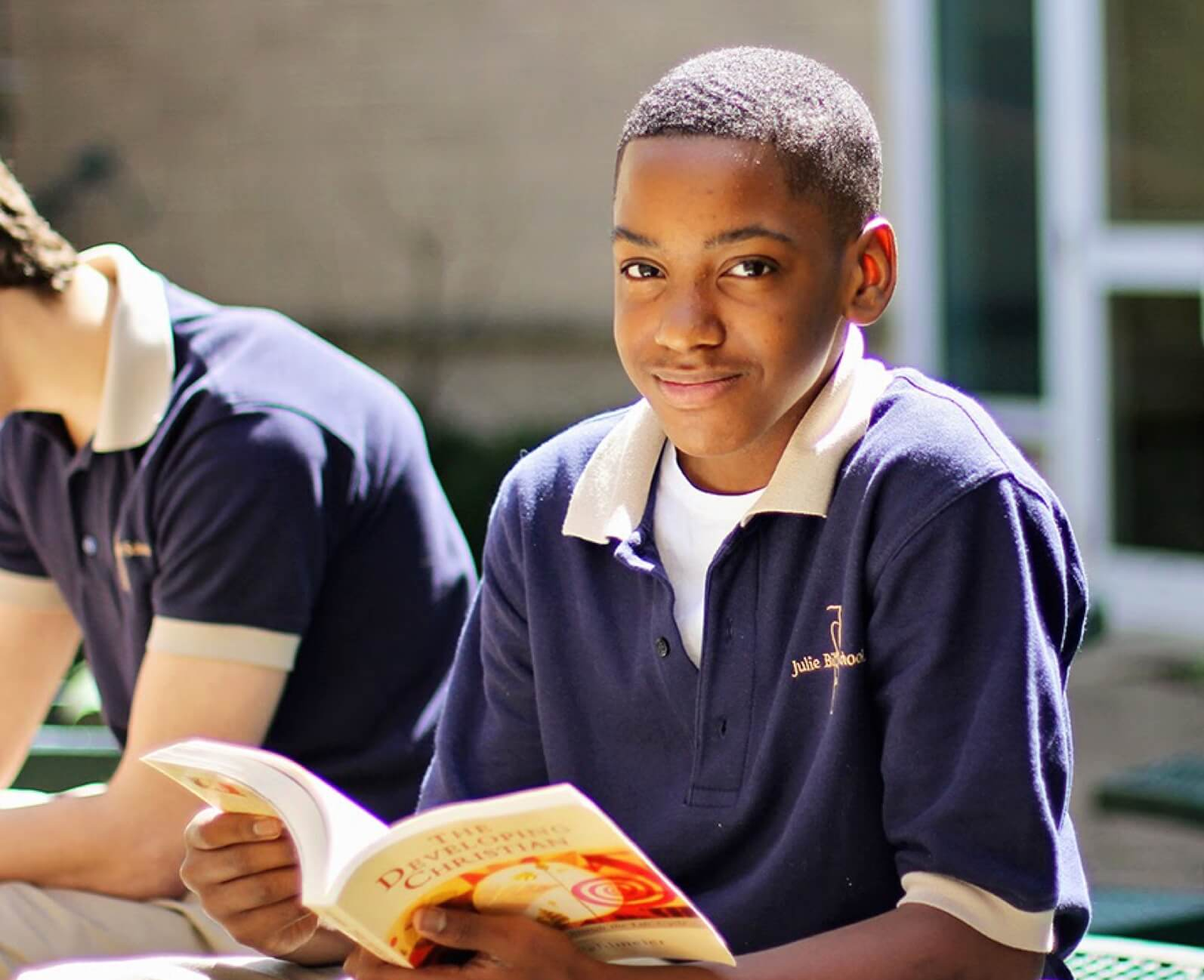 boy-smiling-holding-book